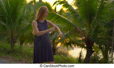 Superslowmotion shot of a beautiful young woman applying an...
