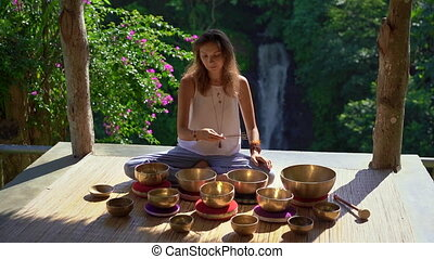 Superslowmotion shot of a woman master of Asian sacred...