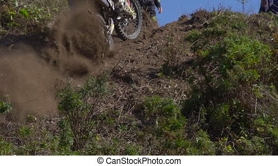 Superslowmotion shot of an enduro motorcycle race.