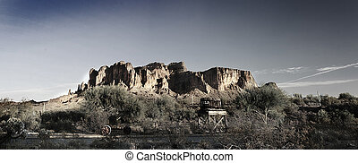 A Wild West scene of Superstion Mountain in Arizona.
