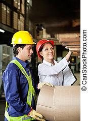Supervisor And Foreman Checking Stock