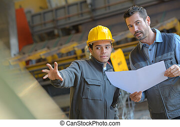 supervisor and manual worker in metal industry