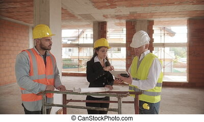 Supervisor Engineer And Manual Worker Meeting In Construction Site