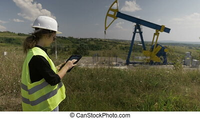 Supervisor engineer woman using a tablet pc inspecting...