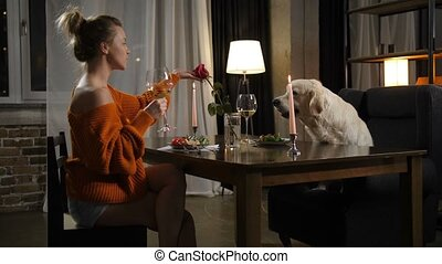 Supper of best friends: pretty woman and cute dog - ...