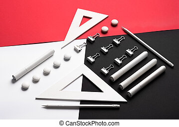 Supplies on the white red and black background table