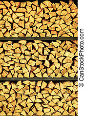Supply of firewood for the fireplace are stacked on the shelves.