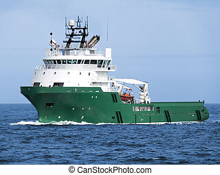 Offshore oil and gas platform supply vessel underway at sea.