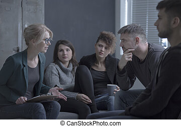 Support group meeting with psychologist