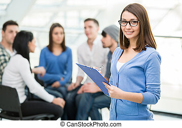 Support Group - Young woman with a tablet and a group of ...