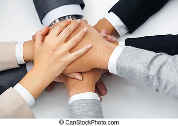 Support - Image of business people hands on top of each...