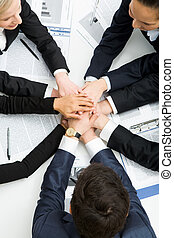 Support - Image of business people with their hands on top ...