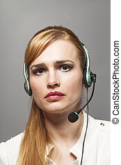 Support phone operator in headset isolated on gray background