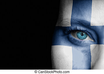 Supporter of Finland - A young female with the flag of...