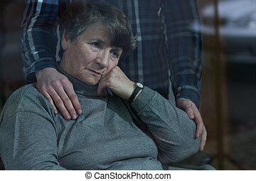 Supportive son - Senior depressed woman and her supportive...