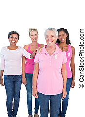 Supportive women wearing pink tops and breast cancer ribbons...