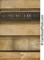 Supreme court sign on an old stone building