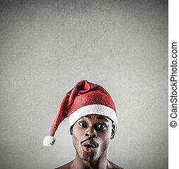 Suprised man in Santa hat