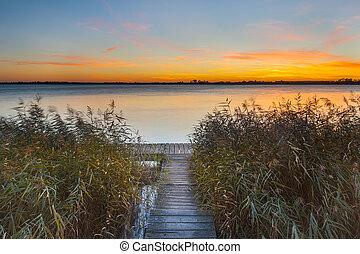 sur, jetée, rivage lac, coucher soleil, orange