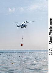 sur, panier, abaissé, mer, water., prise, hélicoptère, rouges