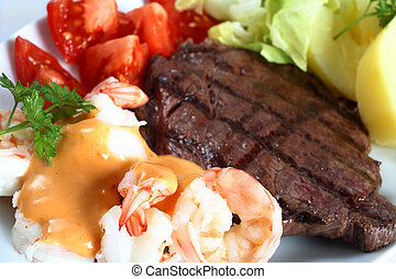 Surf and turf meal - A meal of steak and prawns