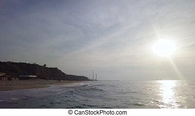 Surf at coastline of mediterrian sand beach