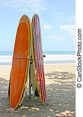 Surf boards standing on Kuta Bali beach