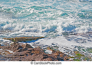 surf by the rocks