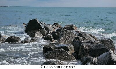 Surf in the rocks. Ostia, Italy
