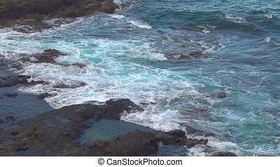 Surf of Atlantic Ocean and rocky beach. Tenerife, The...
