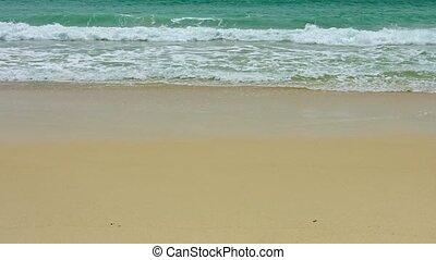 Surf on a sandy tropical beach