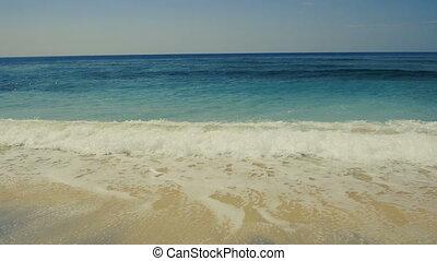Surf on a tropical sand beach