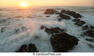 Surf on the coastal rocks leading