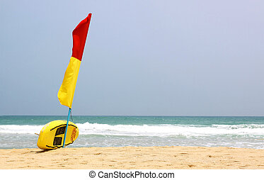 Surf Rescue surfboard and flags on Naiharn beach, Phuket...