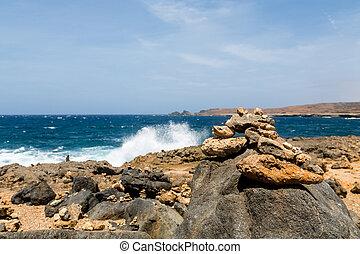 Surf Splashing Over Black Coral Rocks