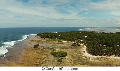 Surf spot on the island of Siargao called cloud 9. - Aerial...