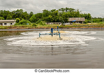surface aerators in waste water pond at landfill site use for make the waste water to clean water