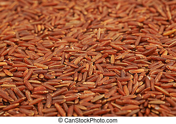 Surface covered with the red rice as a backdrop food texture...