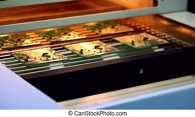 Machine places elements on circuit boards
