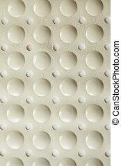 Surface of a pliable rubber bath mat