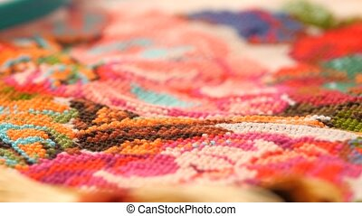 Surface of bright embroidery with flowers, rotation - A...