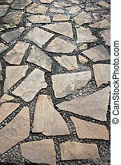 surface of corridor stone in the garden.