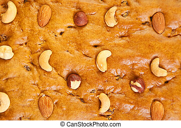 Surface of homemade fresh honey cake with nuts