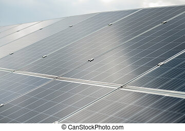 Solar energy. Large dark smooth surface of the solar panel receiving sunlight on fine day