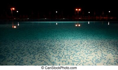 Surface of the water pool, lighted a lantern chamber
