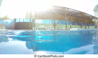 Surface of water in hotel swimming pool underwater shot