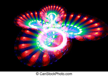 Surface with light painting streaks of different color in form butterfly