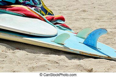 Surfboard and towels 2