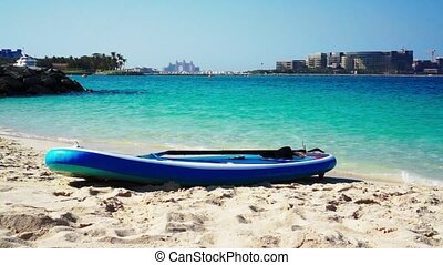Surfboard on the beach. Sea blue water. - Surfboard on the...