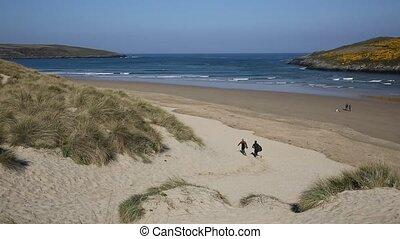 Surfer beach Crantock Cornwall uk